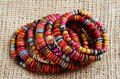 Ethnic decoration. Natural wood bracelet consisting of colored beads of different sizes royalty free stock images
