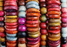 Ethnic decoration. Natural wood bracelet consisting of colored beads of different sizes royalty free stock photo