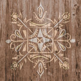 Ethnic design symbol on realistic wood texture Royalty Free Stock Photography