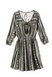 Ethnic dress isolated. Ethnic silk mini dress on white background Stock Images