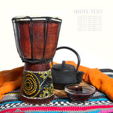 Ethnic drum and black tea Royalty Free Stock Photos