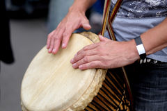 Ethnic drum in the hands of the concert participant. Ethnic drum in the hands of a musician - participant in a concert of percussion music during the performance Stock Images