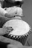 Ethnic drum in the hands of the concert participant. Ethnic drum in the hands of the participant of the percussion music concert during the performance of the Stock Images