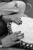 Ethnic drum in the hands of the concert participant. Ethnic drum in the hands of the participant of the percussion music concert during the performance of the Royalty Free Stock Photos