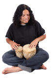 Ethnic drummer. Funky long haired ethnic African American and Native Indian male playing bongo drums on a white background Royalty Free Stock Photography