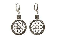 Ethnic earrings isolated. Ethnic bronze earrings on white background Stock Photo