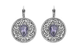 Ethnic earrings isolated. Pair of ethnic silver earrings on white background Stock Photo