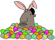 Ethnic Easter bunny in a pile of decorated eggs Stock Image