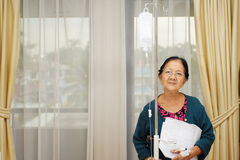 Ethnic elderly woman patient in hospital ward Stock Photos