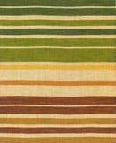 Ethnic fabric of coloured stripes. Ethnic fabric with pattern of coloured stripes Royalty Free Stock Photos