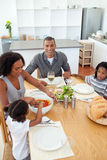 Ethnic family dining together. In the kitchen royalty free stock photos