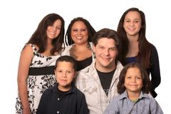 Ethnic Family. Good looking young, happy, ethnic family with four children and tattooed and pierced parents stock images