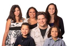 Ethnic Family. Good looking young, happy, ethnic family with four children and tattooed and pierced parents stock photo