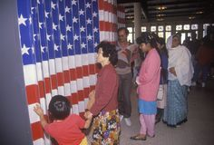 Ethnic family visiting an exhibit at Ellis Island National Park, New York Stock Photos