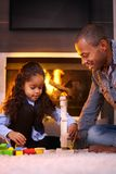Ethnic father and daughter playing together Royalty Free Stock Photo