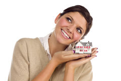 Ethnic Female Daydreaming with Small House Royalty Free Stock Photo