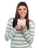 Ethnic Female Holding Piggy Bank on White stock photos