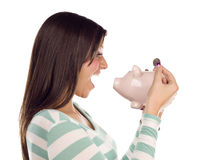 Ethnic Female Putting Coin Into Piggy Bank Royalty Free Stock Photos