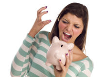 Ethnic Female Yelling At Piggy Bank on White Stock Photo