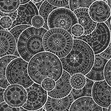 Ethnic floral mandalas, doodle background circles in vector. Seamless pattern. Stock Images