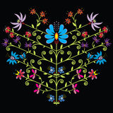 Ethnic folk floral pattern in heart shape on black background Stock Photography