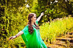 Ethnic girl in green with long brown hair Royalty Free Stock Image