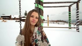 Ethnic girl with long hair. well with water. Snowy winter in the village.  stock video footage