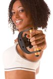 Ethnic girl with Resistance Band (selective focus). Dark skinned woman stretching using rubber band (selective focus on hand Royalty Free Stock Images
