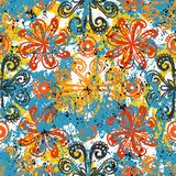 Ethnic grunge pattern. Vector floral grunge pattern on splash and sprayed watercolor paint. Bold ethnic and tribal print with flowers in bright color on hand Royalty Free Stock Image