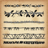 Ethnic hand drawn vector line border set and hipster scribble design element. Ink Stock Photography