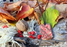 Ethnic handmade magic red clay amulet Stock Image