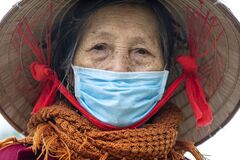 Ethnic Hmong old woman on a street of Sapa, North Vietnam