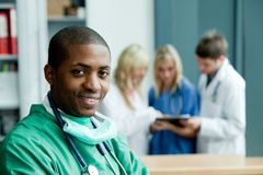 ethnic hospital smiling surgeon Стоковое Изображение