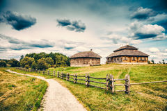 Ethnic house on rural landscape Stock Photography