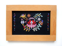 Ethnic Hungarian embroidery. A sample of ethnic hungary cross stitch embroidery, done in colourful cotton yarns. Mezokovesd, embroidered in colourful letters Royalty Free Stock Photography