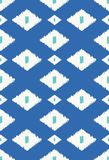 Ethnic ikat tribal seamless pattern. Modern ikat tribal seamless pattern for web design, home decor, or fashion illustration. In blue, white and turquoise Stock Image