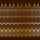 Ethnic indian line art border. Ethnic indian golden line art border in mehendi ethnic style on a brown background Royalty Free Stock Photography
