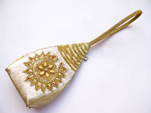 Ethnic Indian Purse. An ethnic indian golden purse decorated with beads and sequence embroidery work stock photo