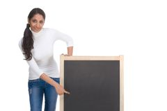 ethnic Indian student by blackboard. Friendly Indian college student woman by chalkboard Royalty Free Stock Images