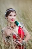 Ethnic woman with apples on grass royalty free stock photo