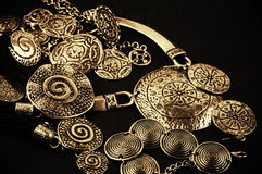 Ethnic jewelry. Collection of golden ethnic jewelry on black background Royalty Free Stock Photo