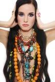 Ethnic jewels. Beautiful brunette with plenty of stylish ethnic jewels Stock Image