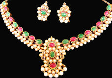 Ethnic Jewerlery Set. An ethnic beaded jewelery set with red coral beads, emerald stones and pearls Stock Images