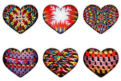 Ethnic knitted patterns of different forms in the form of hearts isolated from the background. Several on a white background ethnic knitted patterns of different Royalty Free Stock Photo