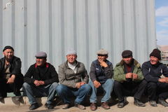 Ethnic Kyrgyz workers in Kochkor, Kyrgyzstan, central Asia. Royalty Free Stock Photography