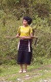 Ethnic Lu  female. Woman of the ethnic Lu from the fields. It was a departure from its traditional dress, but retained the traditional headdress and robe Royalty Free Stock Photography