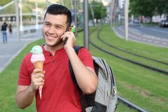Ethnic male calling by phone in the summer.  Royalty Free Stock Photos