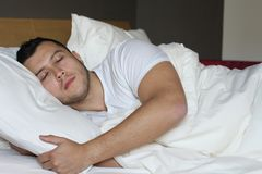 Ethnic male sleeping in comfortable position.  Royalty Free Stock Images