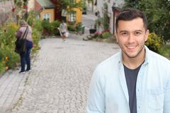 Ethnic male smiling isolated on the street.  Royalty Free Stock Photography
