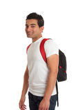Ethnic male student smiling. Ethnic male mixed race student standing with a backpack rucksack on his back and smiling Stock Photo